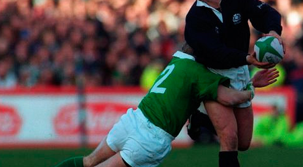 Craig Chalmers is tackled by Mark McCall at Lansdowne Road in 1998 Photo: SPORTSFILE / David Maher