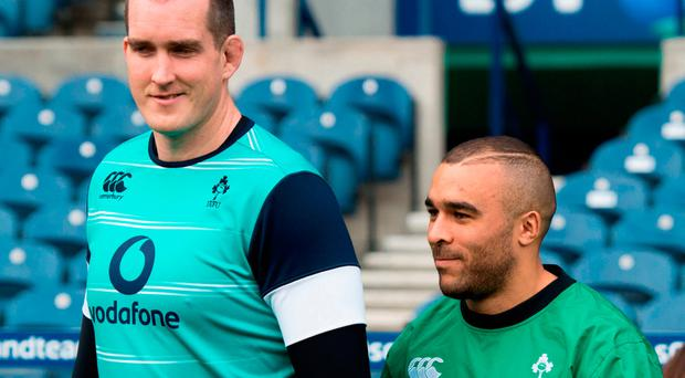 Two players who are sure to play a major role in Ireland's aerial tactics against Scotland, Devin Toner and Simon Zebo, enter the Murrayfield pitch hand-in-hand for yesterday's Captain's Run Photo: Ian Rutherford/PA Wire