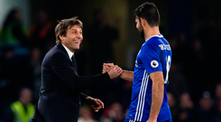 Antonio Conte congratulates Diego Costa after Chelsea's victory against Stoke. Photo: Craig Mercer/Getty Images