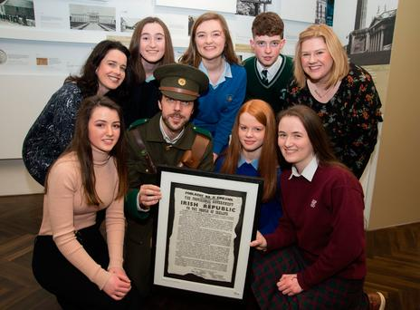 Pictured are Aline FitzGerald (general manager, GPO Witness History), Emma Beashel (St Gerard's, Bray), Aoife O'Sullivan (Christ the King Secondary School, Cork), Aindrias Lyons (Coláiste Chríost Rí, Cork), Ann-Marie Smith (education manager, GPO Witness History), Ailish Grainne Bradley (St Mary's Secondary School, Cork), Aiden J Collins (alias Tom from the Irish Volunteers), Aishling Kelly (St Joseph's Secondary School, Rochefortbridge). Missing from photograph: Cian Morey (Coláiste an Spioraid Naoimh) Photo: Paul Sherwood