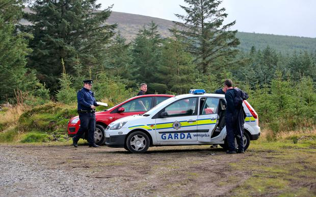 Gardaí on Ballinascorney Hill, where the body of Michael McCoy was found in September. Photo: Colin Keegan/Collins