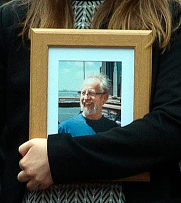 Photo of Michael McCoy carried by a mourner at his funeral Photo: Tony Gavin