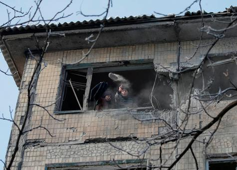 Local residents are seen in a building which was damaged during fighting between the Ukrainian army and pro-Russian separatists in the government-held industrial town of Avdiyivka, Ukraine
