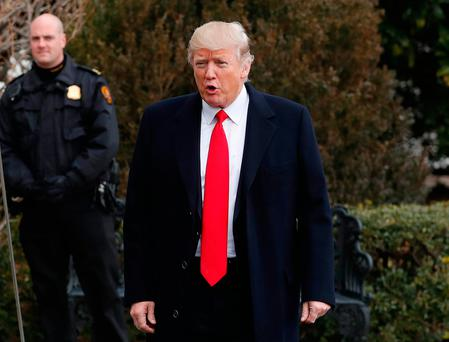 President Donald Trump pauses to speak to media as he walks from White House to the South Lawn of the White House in Washington. Photo: AP