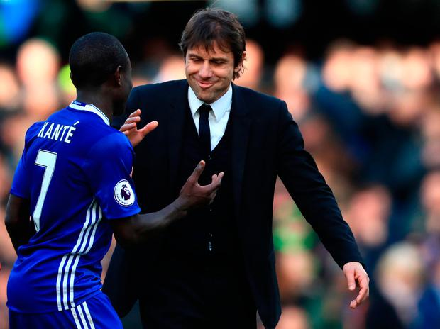 Chelsea's N'Golo Kante (left) and Chelsea manager Antonio Conte after the final whistle