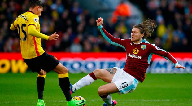 Watford's Jose Holebas is fouled by Burnley's Jeff Hendrick who was sent off