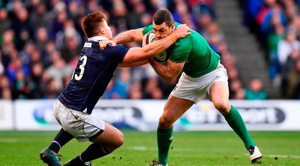 Rob Kearney of Ireland is tackled by Huw Jones of Scotland during the RBS Six Nations Rugby Championship match between Scotland and Ireland. Photo by Ramsey Cardy/Sportsfile