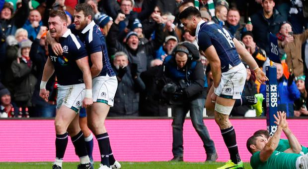 Scotland's Stuart Hogg celebrates after scoring the first try