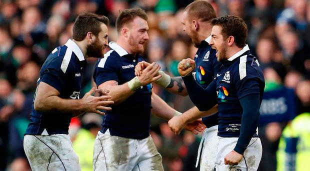 Scotland's Greig Laidlaw celebrates with team mates after scoring the winning penalty. Action Images via Reuters / Lee Smith