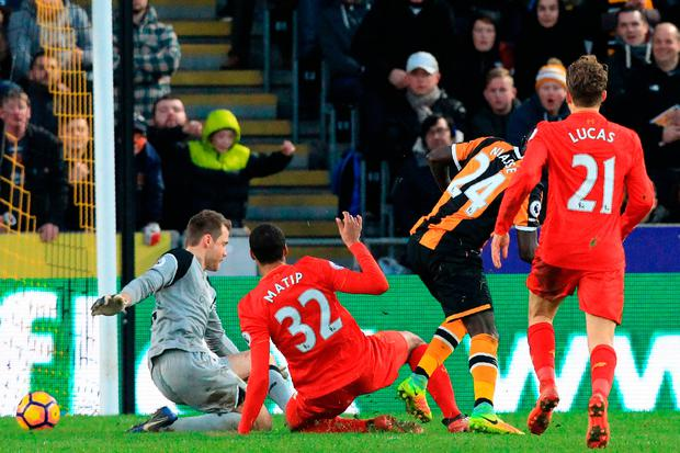 Hull City's Senegalese striker Oumar Niasse (2nd R) scores their second goal