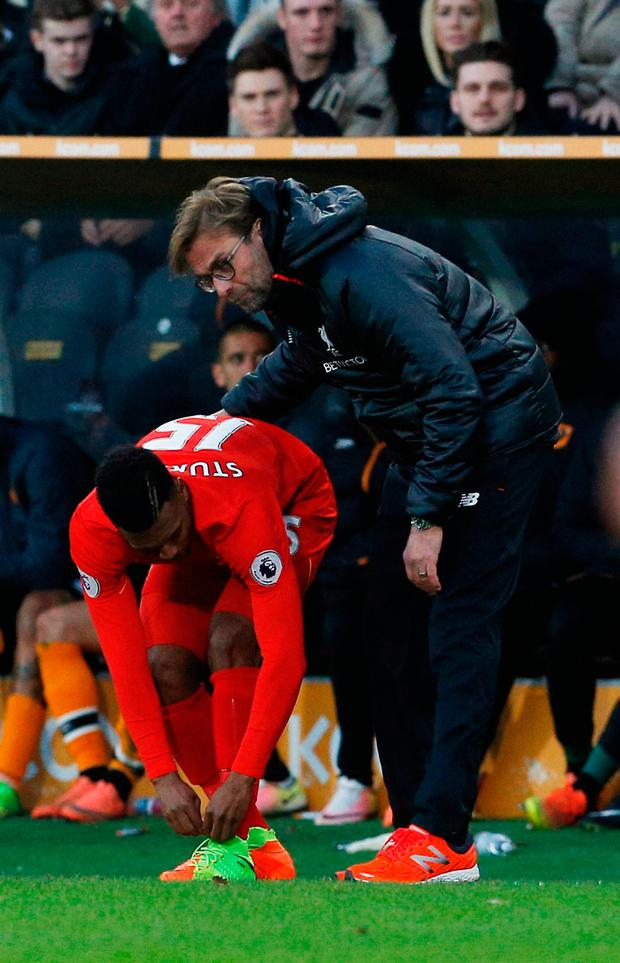 Liverpool's Daniel Sturridge is spoken to by manager Jurgen Klopp before coming on