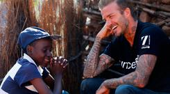 Handout file photo issued by UNICEF dated 07/06/2015 of UNICEF Goodwill Ambassador David Beckham meeting Sebenelle, 14, in Makhewu, Swaziland Photo: Modola/UNICEF/PA Wire