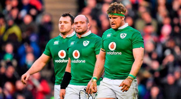 Dejected Ireland players, from left, Cian Healy, captain Rory Best and Jamie Heaslip leave the pitch after the RBS Six Nations Rugby Championship match between Scotland and Ireland at BT Murrayfield Stadium in Edinburgh, Scotland. Photo by Brendan Moran/Sportsfile