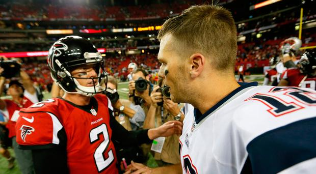Tom Brady and Matt Ryan shake hands after their teams met last September. Photo: Kevin C. Cox/Getty Images