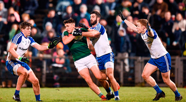 Mayo's Jason Doherty battles against Monaghan's Darren Hughes, Neil McAdam and Colin Walshe. Photo: Stephen McCarthy/Sportsfile