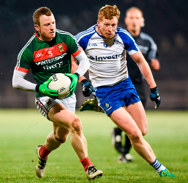 Mayo's Colm Boyle is hounded by Kieran Hughes of Monaghan. Photo: Stephen McCarthy/Sportsfile
