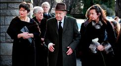 Farewell: Des O'Malley at the funeral Mass of his wife Patricia at the Church of the Sacred Heart in Donnybrook, with his daughter Fiona (left). Photo: Steve Humphreys