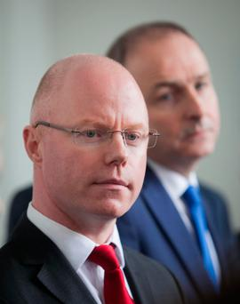 Moving on: Former Independent TD Stephen Donnelly with Fianna Fail Leader Micheal Martin TD as he announced he was joining the party. Photo: Gareth Chaney Collin
