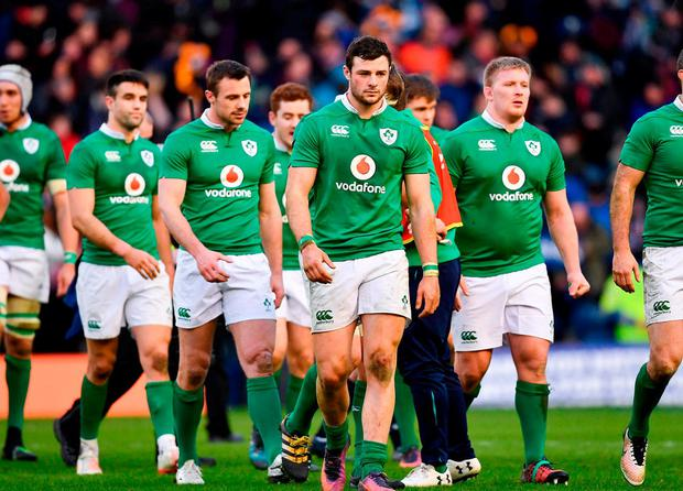 A dejected Ireland leave the field. Photo: Ramsey Cardy/Sportsfile