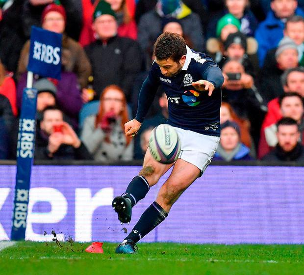 Scotland's Greig Laidlaw kicks a penalty at full time to leave the final score 27-22 to Scotland. Photo: Brendan Moran/Sportsfile