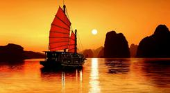 In Halong Bay you will sail among hundreds of oddly-shaped outcrops which jut out from the still blue waters - and time will stand still