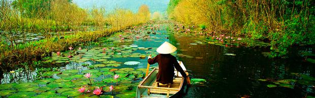 Rural Vietnam is blessed with lush jungle greenery and lotus flowers