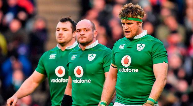 Dejected Ireland players, from left, Cian Healy, captain Rory Best and Jamie Heaslip leave the pitch. Photo: Brendan Moran/Sportsfile
