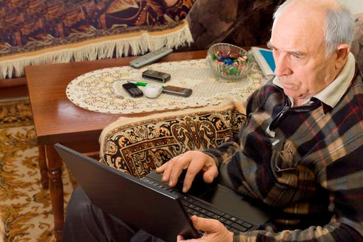 Operating a computer, especially for an older person, can be challenging. Stock Image