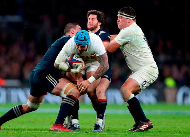 England's Jack Nowell trying to evade tackles. Photo: David Davies/PA Wire