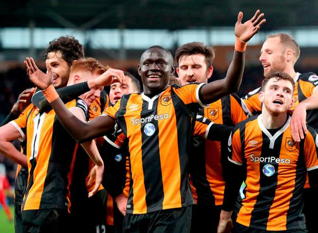 Hull City's Oumar Niasse (centre) celebrates scoring his side's second goal. Photo: Danny Lawson/PA Wire