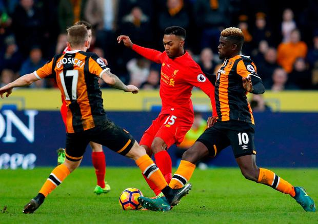 Liverpool's Daniel Sturridge in action with Hull City's Kamil Grosicki and Alfred N'Diaye. Photo: Phil Noble/Reuters