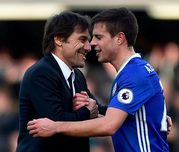 Chelsea manager Antonio Conte and Cesar Azpilicueta celebrate after the game. Photo: Hannah McKay/Reuters