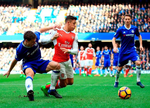 Chelsea's Cesar Azpilicueta (left) and Arsenal's Alexis Sanchez battle for the ball. Photo: John Walton/PA Wire
