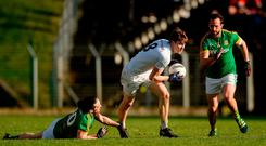 Kevin Feely of Kildare gets past Cillian O'Sullivan, left, and Graham Reilly of Meath during the Allianz Football League Division 2 Round 1 match between Meath and Kildare at Páirc Táilteann in Navan, Co. Meath. Photo by Piaras Ó Mídheach/Sportsfile