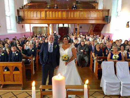 Bride Patricia Doogan and her husband Neil were delighted when a 'Catholic flashmob' took to the alter at their wedding.