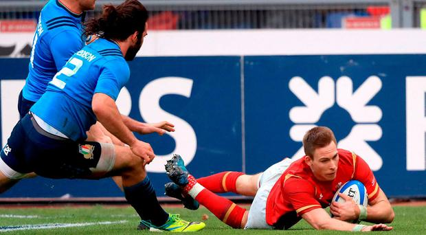 Wales' Liam Williams scores his team's second try during the RBS 6 Nations match at the Stadio Olimpico, Rome