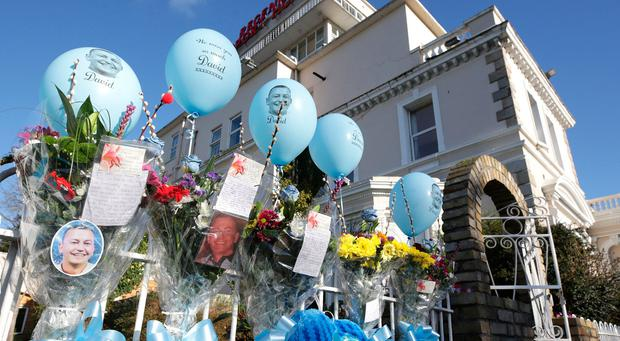 Flowers and Balloons next to the regency Hotel in memory of David Byrne, today is the one year anniversary of his shooting at the regency Hotel.