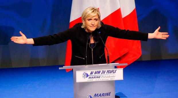 Far-right leader presidential candidate Marine Le Pen gestures as she speaks during a conference in Lyon, France (AP Photo/Michel Euler)