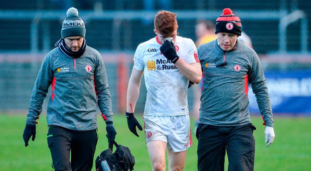 Cathal McShane of Tyrone comes off the field with Matthew Harte, team physiotherapist, left, and Dr Damian O'Donnell, right, during the Allianz Football League Division 1 Round 1 match between Tyrone and Roscommon at Healy Park in Omagh, Co. Tyrone. Photo by Oliver McVeigh/Sportsfile