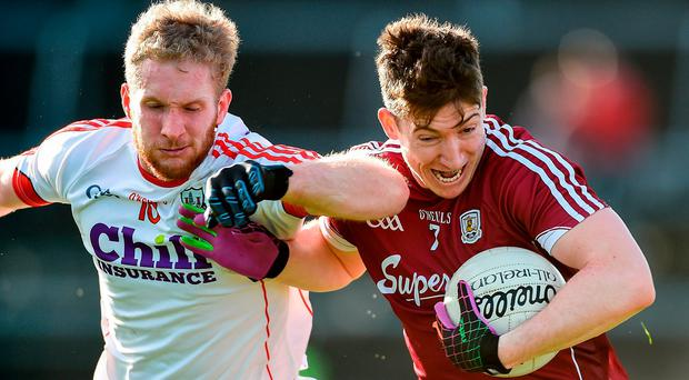 Johnny Heaney of Galway in action against Ruairi Deane of Cork during the Allianz Football League Division 2 Round 1 match between Galway and Cork at Pearse Stadium in Galway. Photo by David Maher/Sportsfile