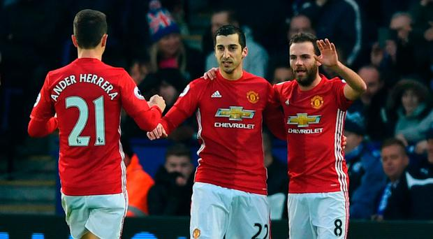 Henrikh Mkhitaryan (C) celebrates with team mates Ander Herrera (21) and Juan Mata (8) as he scores their first goal during the Premier League match between Leicester City and Manchester United at The King Power Stadium
