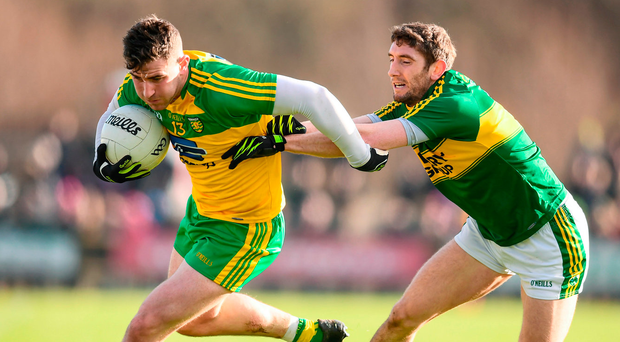 Kerry defender Killian Young tries to keep tabs on Patrick McBrearty of Donegal in yesterday's Allianz NFL clash Photo: Stephen McCarthy/Sportsfile