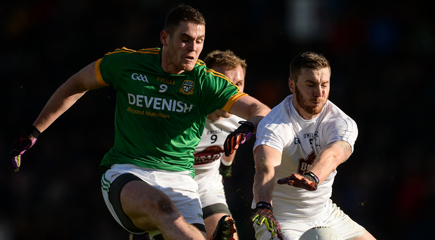 Meath's Bryan Menton is blocked down by Johnny Byrne of Kildare during their Allianz Football League Division 2 Round 1 match. Photo: Piaras Ó Mídheach/Sportsfile