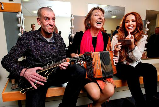 Historian Diarmaid Ferriter, journalist Áine Lawlor and singer Lisa Lambe backstage during rehearsals at 'Give Us A Song' in Liberty Hall, Dublin. Photo: Steve Humphreys