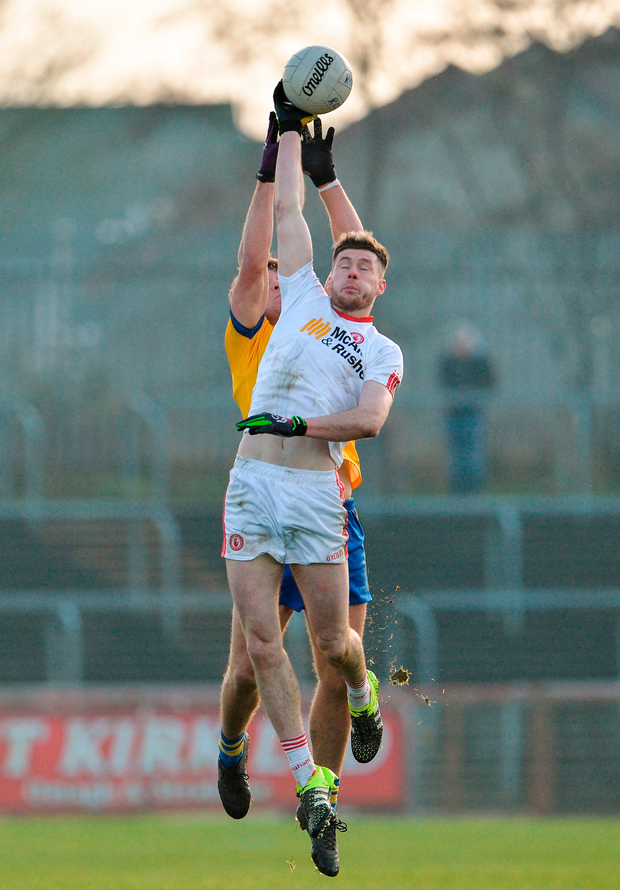 Tyrone's Declan McClure in action against Sean Mullooly of Roscommon Photo: Oliver McVeigh/Sportsfile