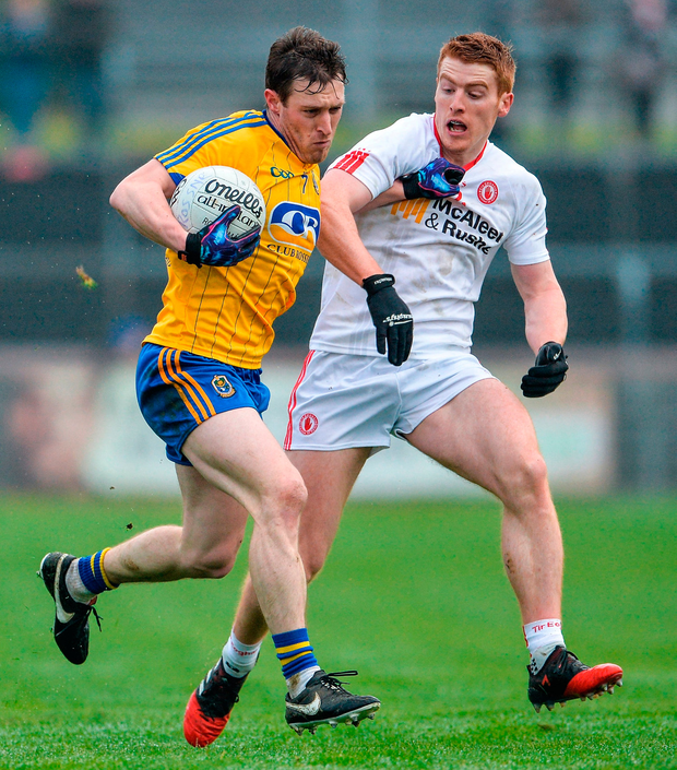 Roscommon's Conor Devaney tries to hold off Peter Harte of Tyrone Photo: Oliver McVeigh/Sportsfile