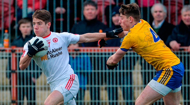 Tyrone's Mark Bradley under pressure from Niall McInerney of Roscommon during the Allianz NFL Division 1 clash in Healy Park Photo: Oliver McVeigh/Sportsfile