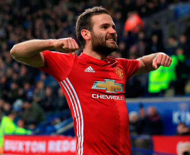 Manchester United's Juan Mata celebrates scoring his side's third goal of the game during the Premier League match against Leicester City. Photo: Mike Egerton/PA