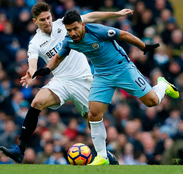 Manchester City's Sergio Aguero in action with Swansea City's Federico Fernandez. Photo: Andrew Yates/Reuters