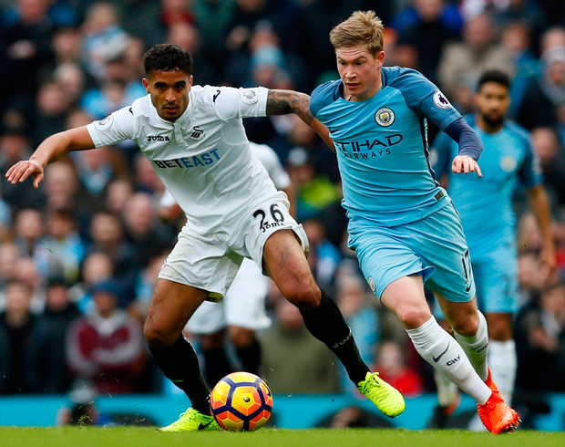 Swansea City's Kyle Naughton in action with Manchester City's Kevin De Bruyne. Photo: Jason Cairnduff/Reuters